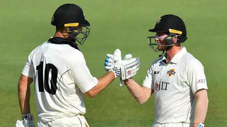 Marsh (left) celebrates with teammate William Bosisto. Picture: AAP