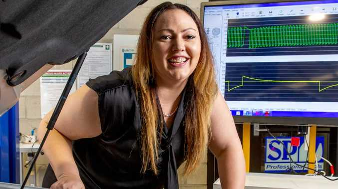 Tiffany Halcoop works on a vehicle at TAFE Queensland SkillsTech. Picture: Richard Walker