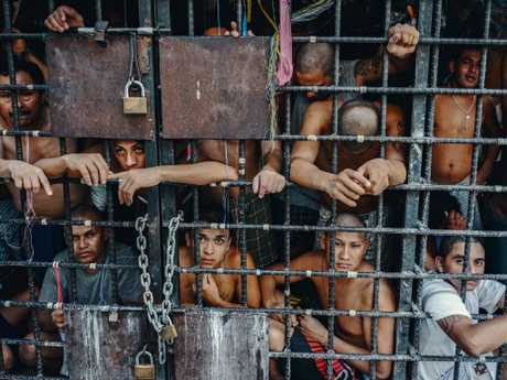 MS-13 gang members languish in one of the three 'gang cages' in the Quezaltepeque police station in San Salvador. Picture: Giles Clarke/Getty Images