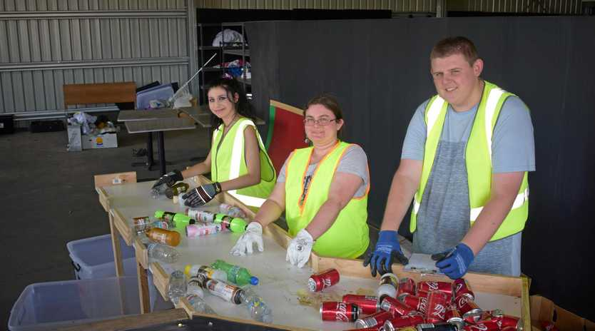 MAKING A CHANGE: Tiffany McKight, Cassidy Farrell and Jack Summers sort cans and bottles at the Containers for Change site in Chinchilla.