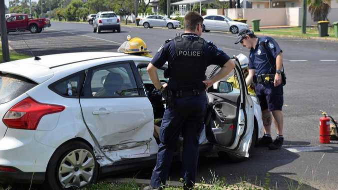 CRASH SCENE: Emergency Services investigate the car which was t-boned in Dalby this morning.