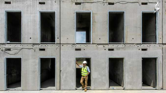 Member for Clarence Chris Gulaptis looks through the cell blocks being constructed at the new correctional centre
