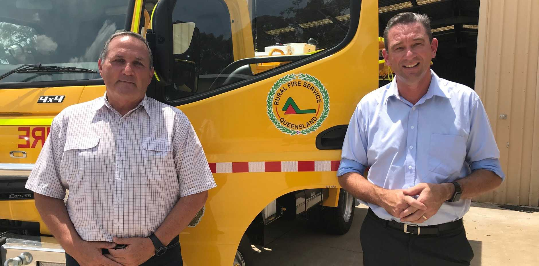 Quik Corp Crows Nest branch manager Mal Assim and Fire and Emergency Services Minister Craig Crawford