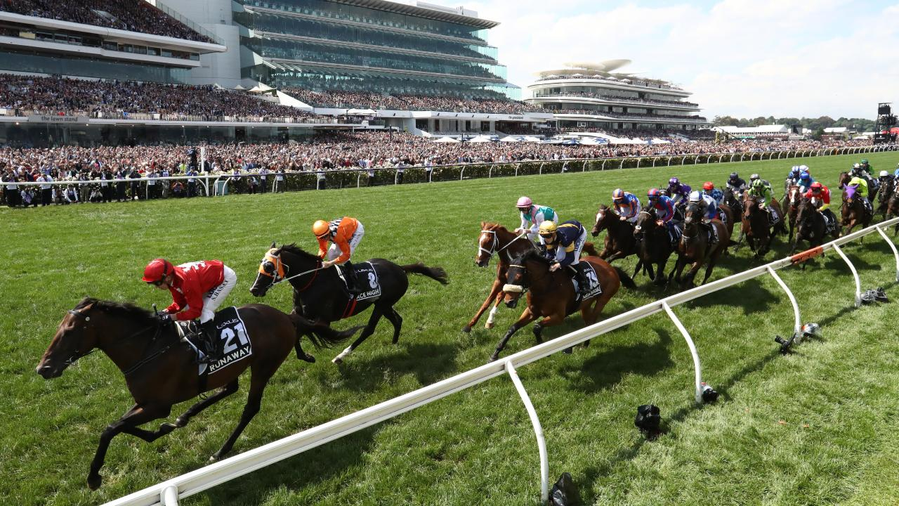 The field makes its way down the home straight on the first occasion. Picture: Getty Images