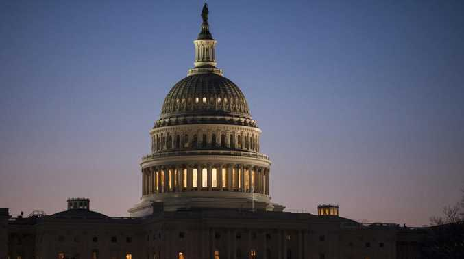 The US Capitol building is seen at dawn in Washington. An overwhelming majority of Americans see the United States as greatly divided on important issues, and few say they believe that will get better any time soon, according to an October poll by The Associated Press-NORC Center for Public Affairs Research. Picture: AP Photo/J. Scott Applewhite