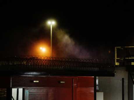 Smoke is seen coming from Don Dale Detention centre. Picture: Keri Megelus