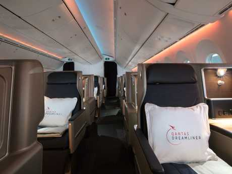 Not even cashed-up business class passengers are immune to scoring freebies. Picture: Qantas