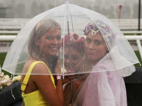 Umbrellas are a girl's best accessory today. Picture: AAP Image/Dave Crosling