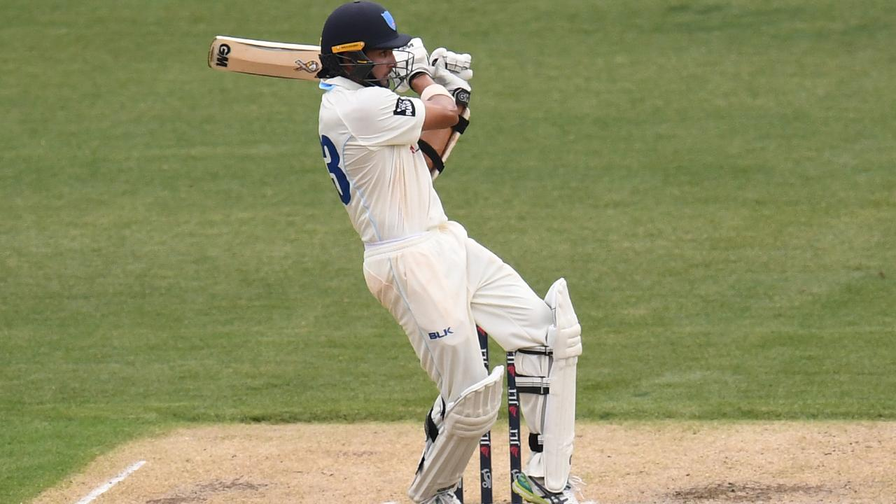 Jason Sangha pulls one to the fence on his way to making a century for NSW.