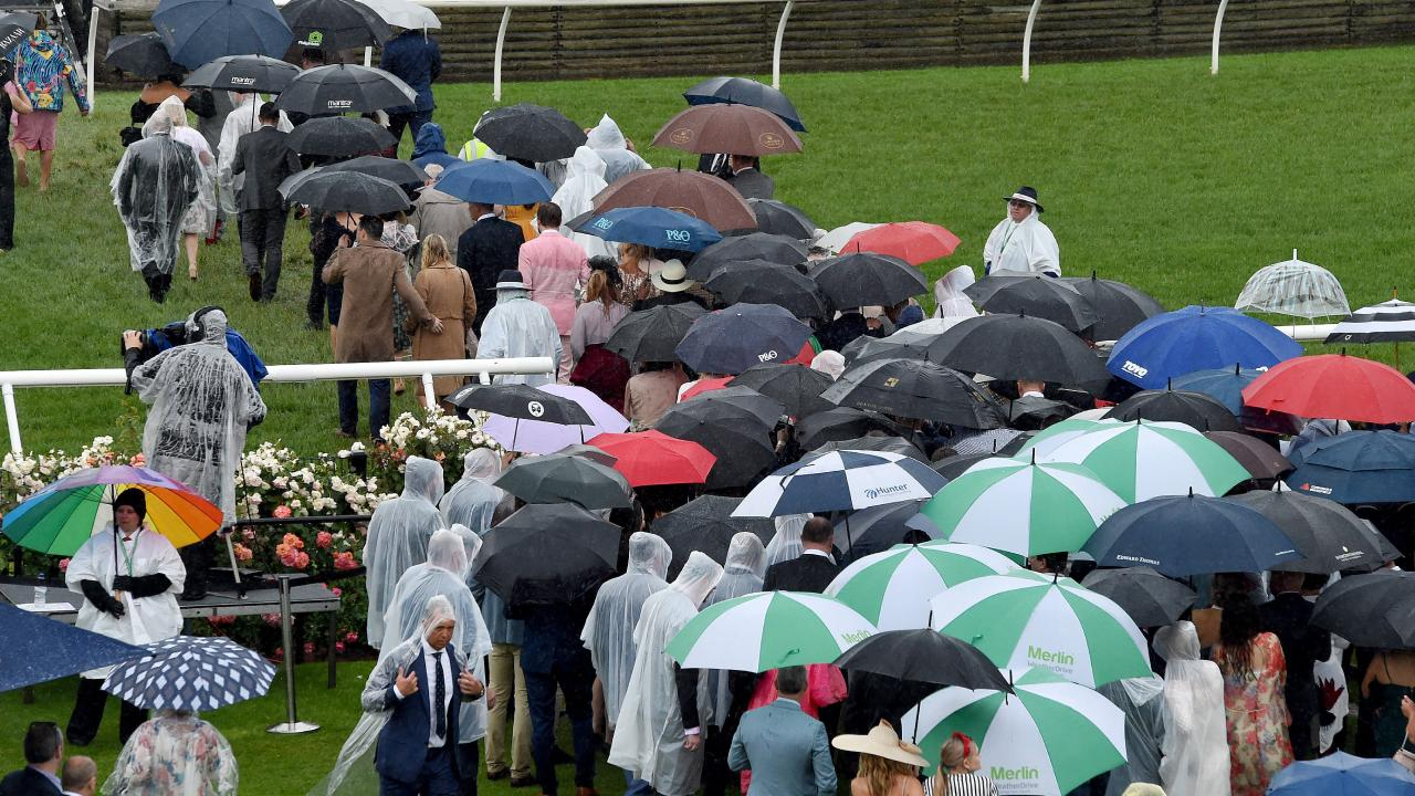It was a wet start to the Melbourne Cup. Picture: Nicole Garmston