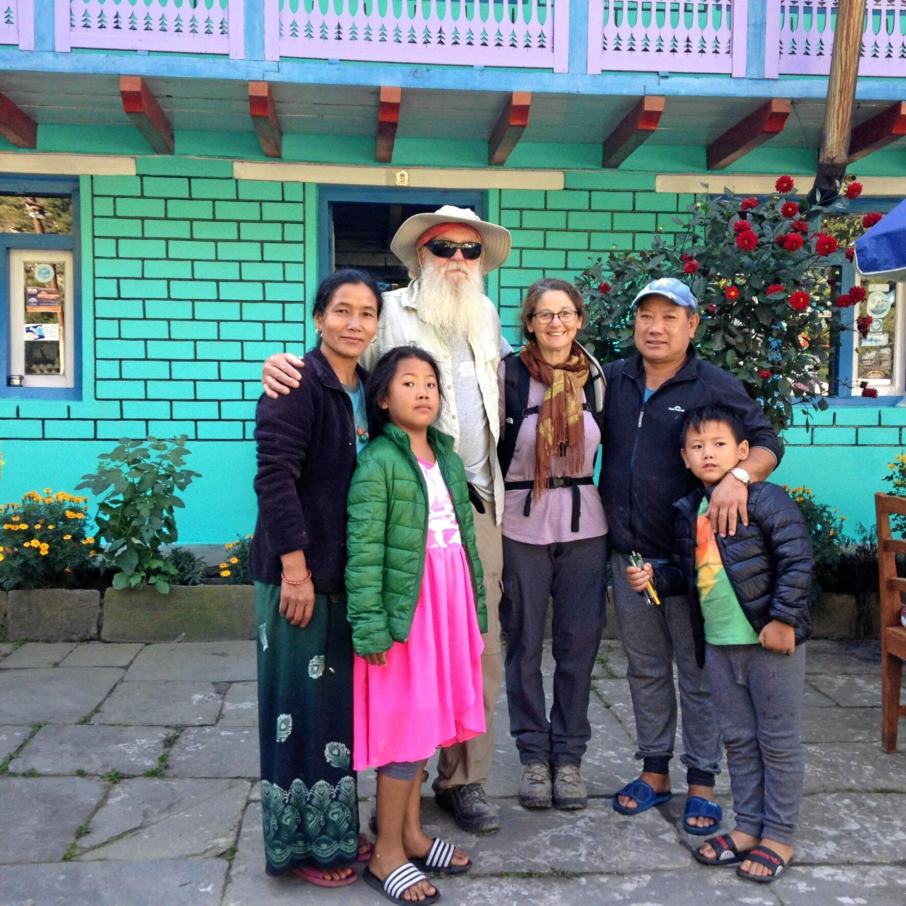Jenny Christie and her husband with the family her daughter stayed with during the earthquake.