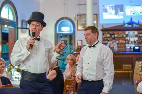 Instrumental in organising the event was (left) Paul Herbert, with Tony Randall (right) auctioning items to raise funds.