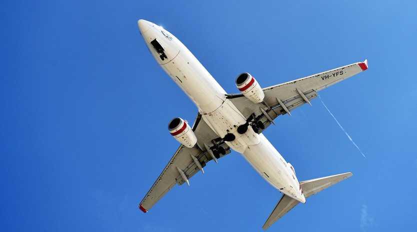 A Virgin plane readies to land at Sunshine Coast Airport