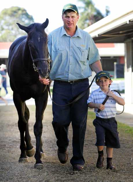 Basil Nolan owner of Raheen Stud has his two kids helping out at the stables at Magic Millions. Basil with his son Basil, four at the time, leading Lot 671 of Lonhro.