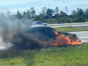 Car engulfed in flames on Bruce Hwy sparks delays