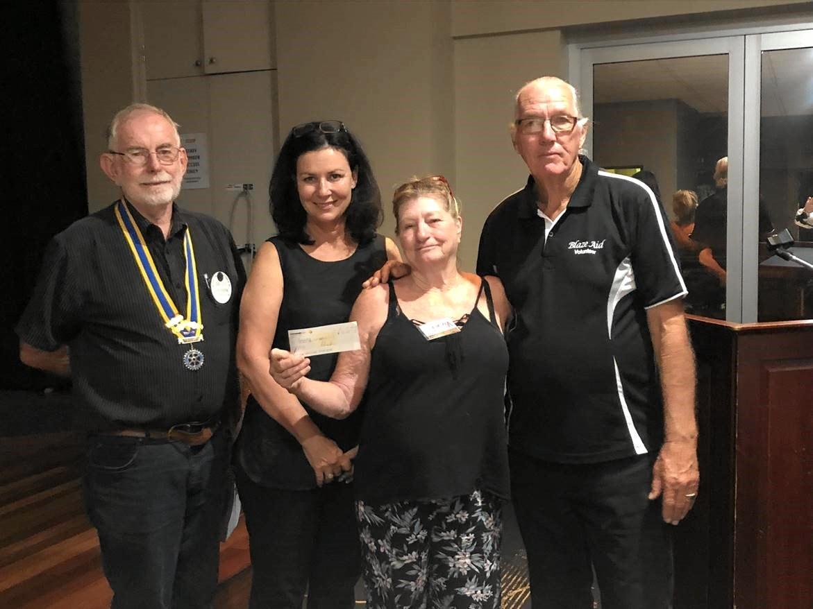 Brian Sansom, Shelley Strachan, and Vicki and Malcolm McIntosh help Rotary Club of Gympie support Blazeaid.