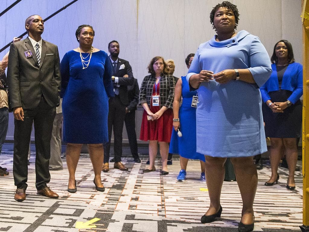 Georgia candidate for governor Stacey Abrams, right, is in a tight contest. Picture: Alyssa Pointer/Atlanta Journal-Constitution via AP