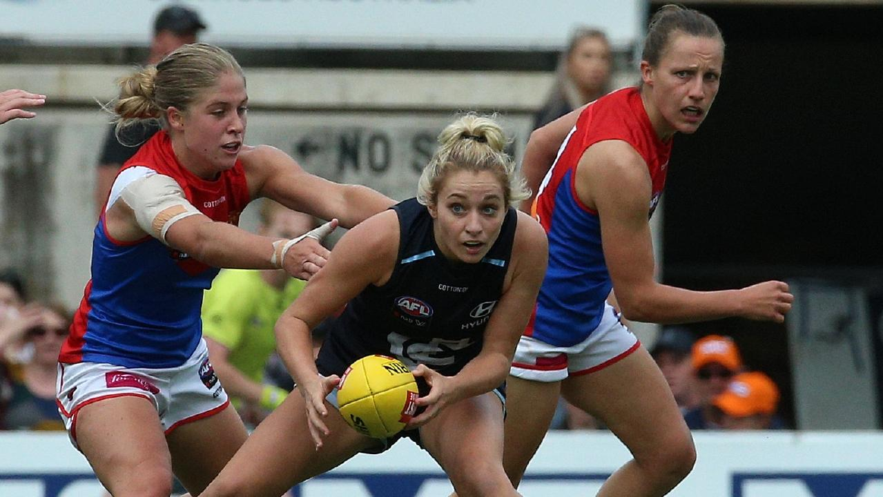 Carlton's Sarah Hosking tries to break away from two Melbourne defenders.  Picture: Hamish Blair