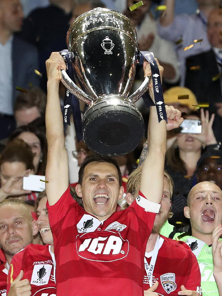 Captain Isaias lifts the FFA Cup following Adelaide United's victory over Sydney FC in the final. Picture: Sarah Reed
