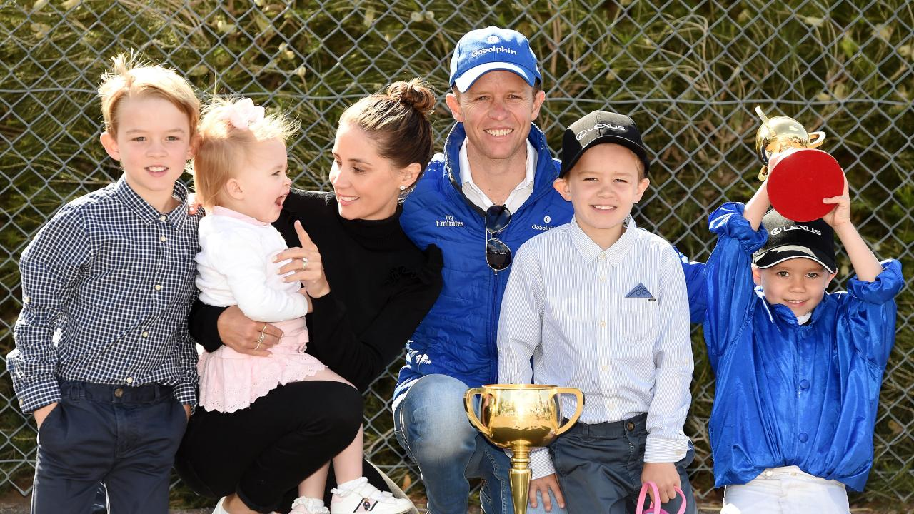 Jockey Kerrin McEvoy with his family the day after winning the Melbourne Cup. From left to right, Charlie 9, Eva 2, Cathy (wife), Jake 8 and Rhys 5. Picture: Nicole Garmston