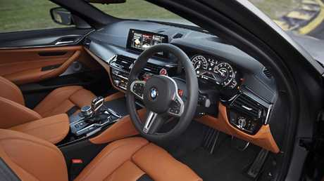 The M5 blends luxury sedan with manic performance.