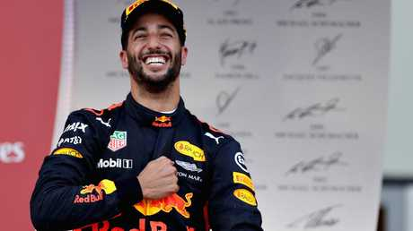 Daniel Ricciardo celebrates a Formula 1 win.