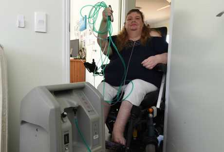 Kathy Nolan showing the Chronicle earlier in the year her oxygen concentrator which requires power, effectively rendering Kathy housebound.