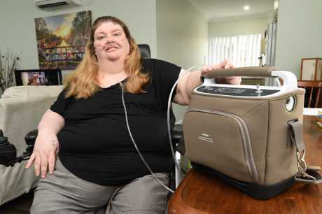 Kathy Nolan with her portable oxygen machine.