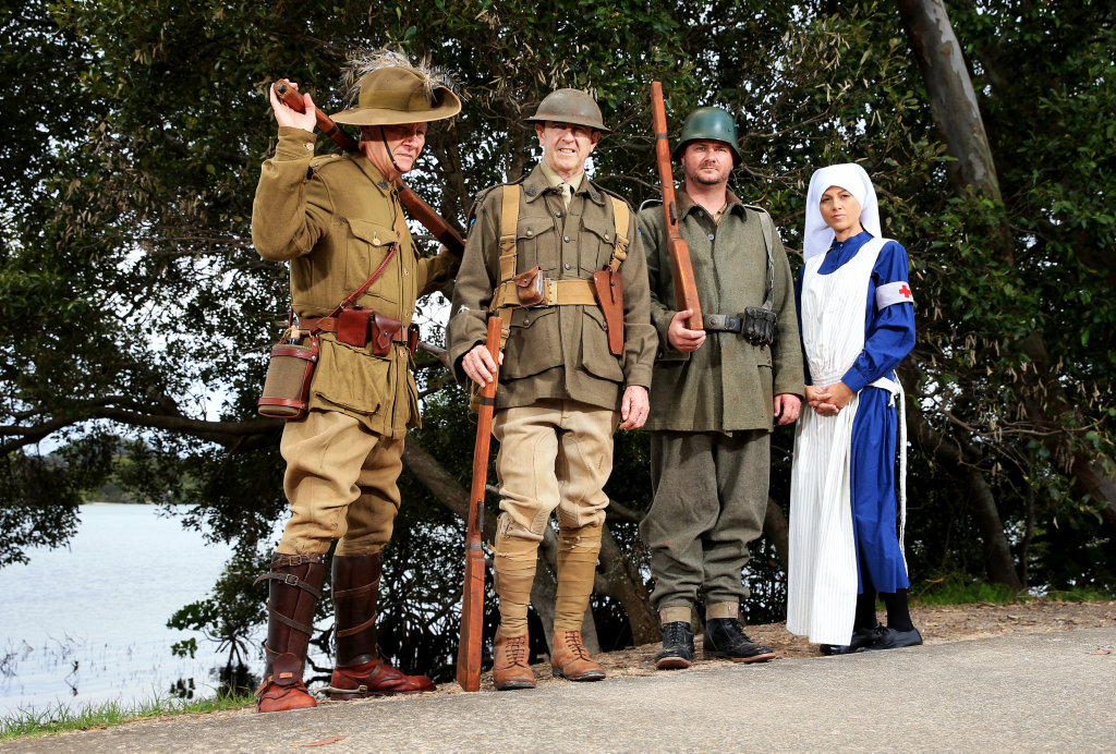 Image for sale: Members of the A Company of the 41st Battalion Australian Army Reserve Unit dressed in authentic World War 1 uniforms get ready for rememberance day : David Bell, Adam Antonini, WO2 Owen Trevorrow and Sergeant Carleanne Cullen