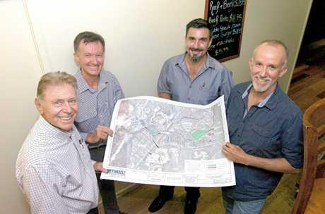 Graham Marsh, Jonathan Mann, Jason Sullivan and Michael Mann with plans for the Station Creek Lifestyle Village.