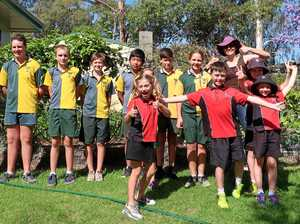 Students follow in green footsteps