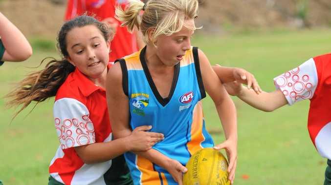 Moore Park State High School's Mikki Noblett in action during a carnival a couple of years ago. The town could now have its own junior team in AFL Wide Bay.