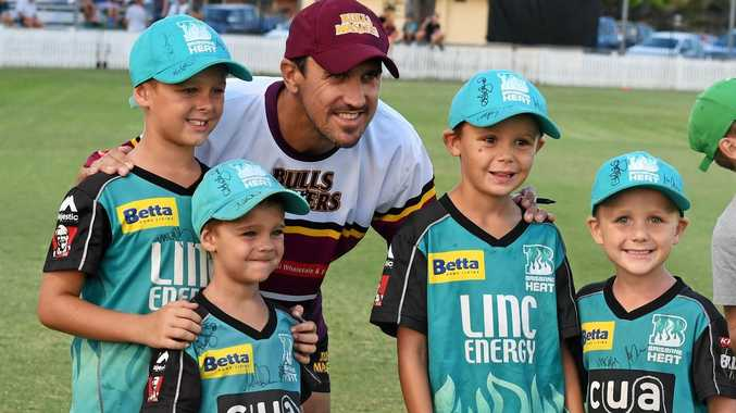RETURNING: Lee Carseldine gets a photo with some little fans at the Bulls Masters v Bundaberg Invitational T20 match at Salter Oval on Saturday night.