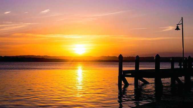 GOLDEN HUE: Sunset on the Richmond River at Ballina.