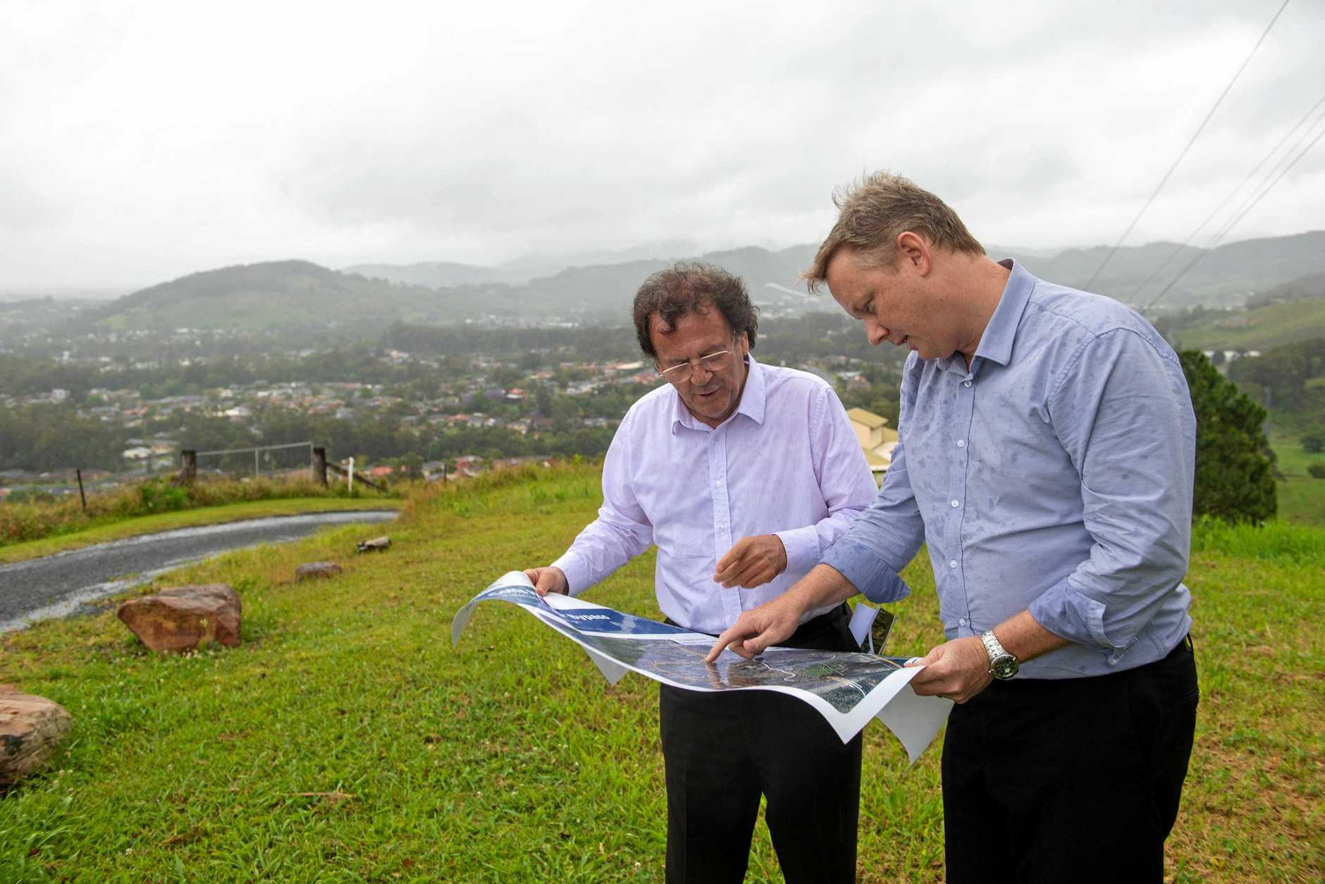 John Alexander and Adam Cameron from the RMS at Gatelys Road on the hill looking over west Coffs today.