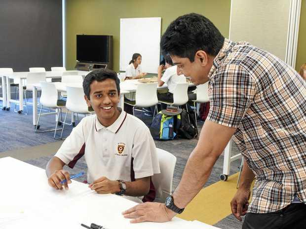 St Peters Lutheran College student Kartik Illuri with USQ Lecturer Dr Nawin Raj.