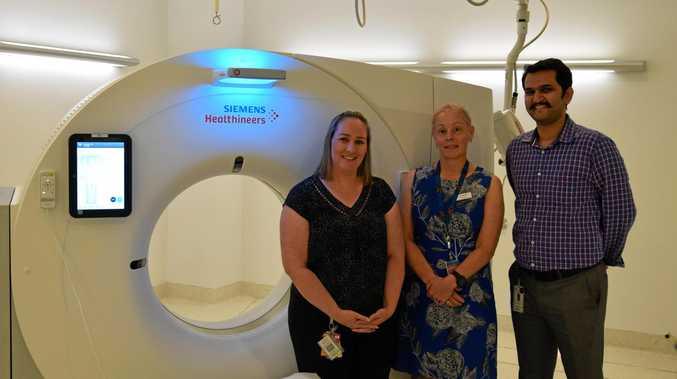 Mackay Base Hospital acting chief of radiography Amada McKinney (left), MHHS chief excutive Jo Whitehead and radiologist Dr Kaustubh Narsinghpura, unveil the new CT scanner.
