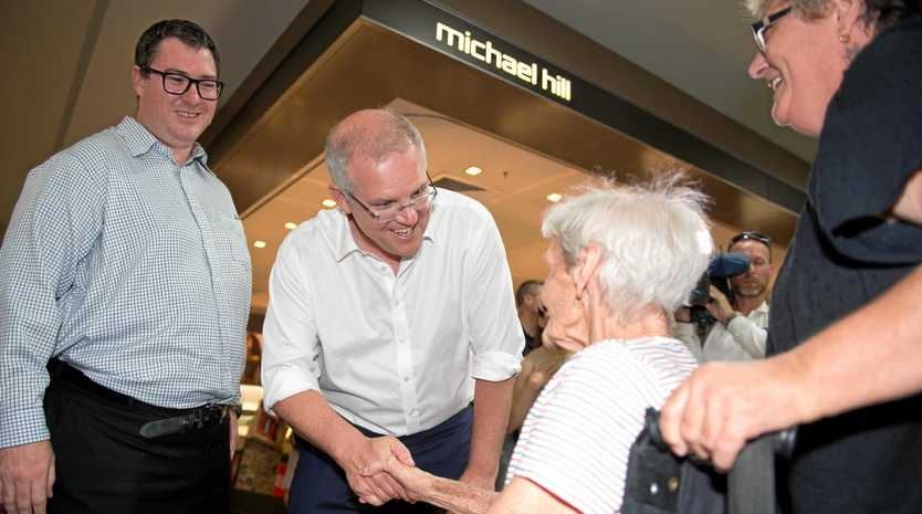 MACKAY VISIT: Prime Minister Scott Morrison shakes the hand of Dulcie Weathered at Caneland Central on Thursday. With him is Federal Member for Dawson George Christensen.