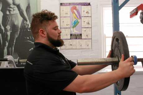 POWER ON: 21-year-old Warwick powerlifter Tom Hardy trained tirelessly in the lead up to breaking the world record squat.