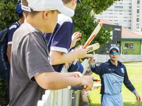 Steve Smith signs autographs for kids during the game at Manly. Picture: Jenny Evans