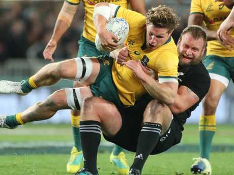 Moody tackles Australia's Michael Hooper during the Bledisloe Cup clash.