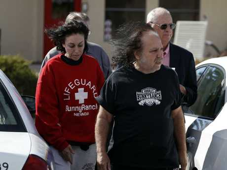 Porn star Ron Jeremy and Hollywood madam Heidi Fleiss leave Dennis Hof's Love Ranch brothel after he had been found dead. Picture: AP