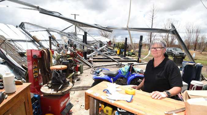 Yengarie farm owner Lyn Dunning, with her destroyed shed after October's tornado.