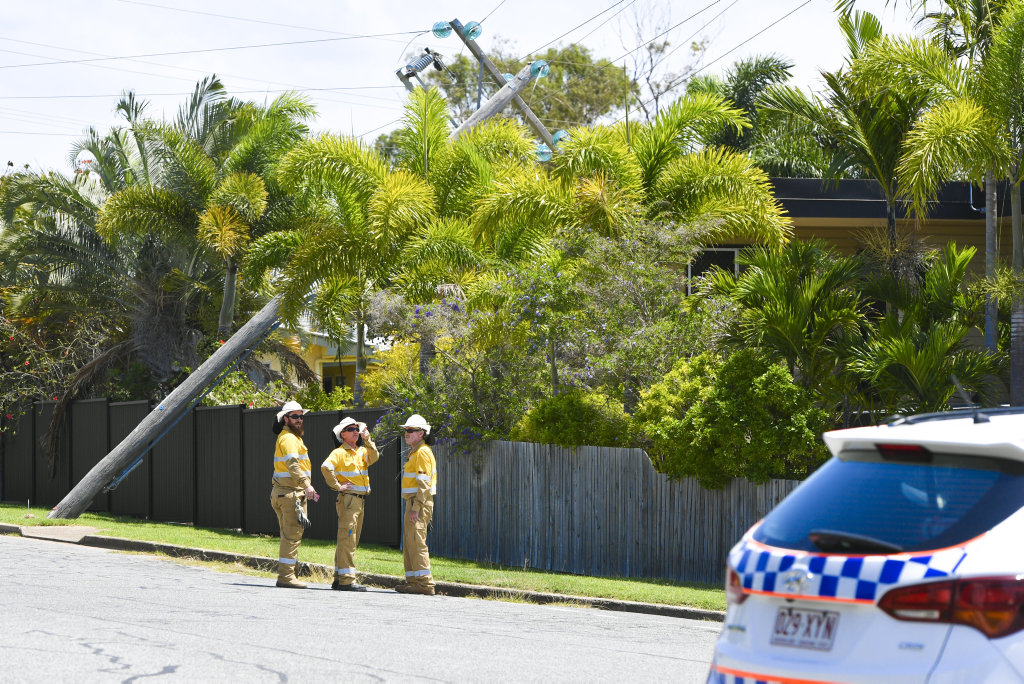 A power pole has fallen on a house in Smith Street, West Gladstone.