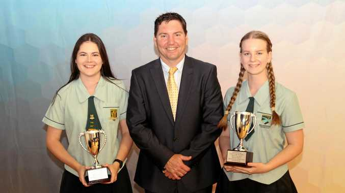 HIGHEST HONOUR: Senior School Dux winners Amy Hungford and Siena Gardner with principal Don McDermid