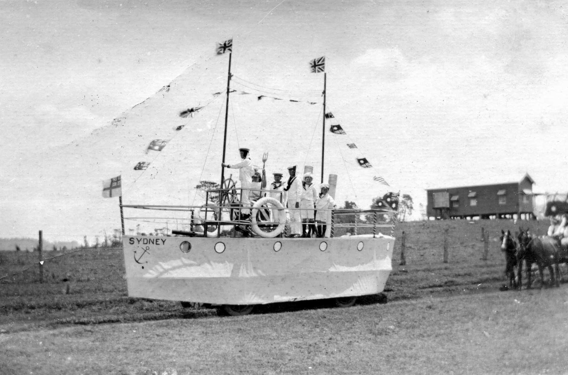 A float in the shape of  HMAS Sydney , participating in the Maleny street parade on Armistice Day on November 11, 1919.