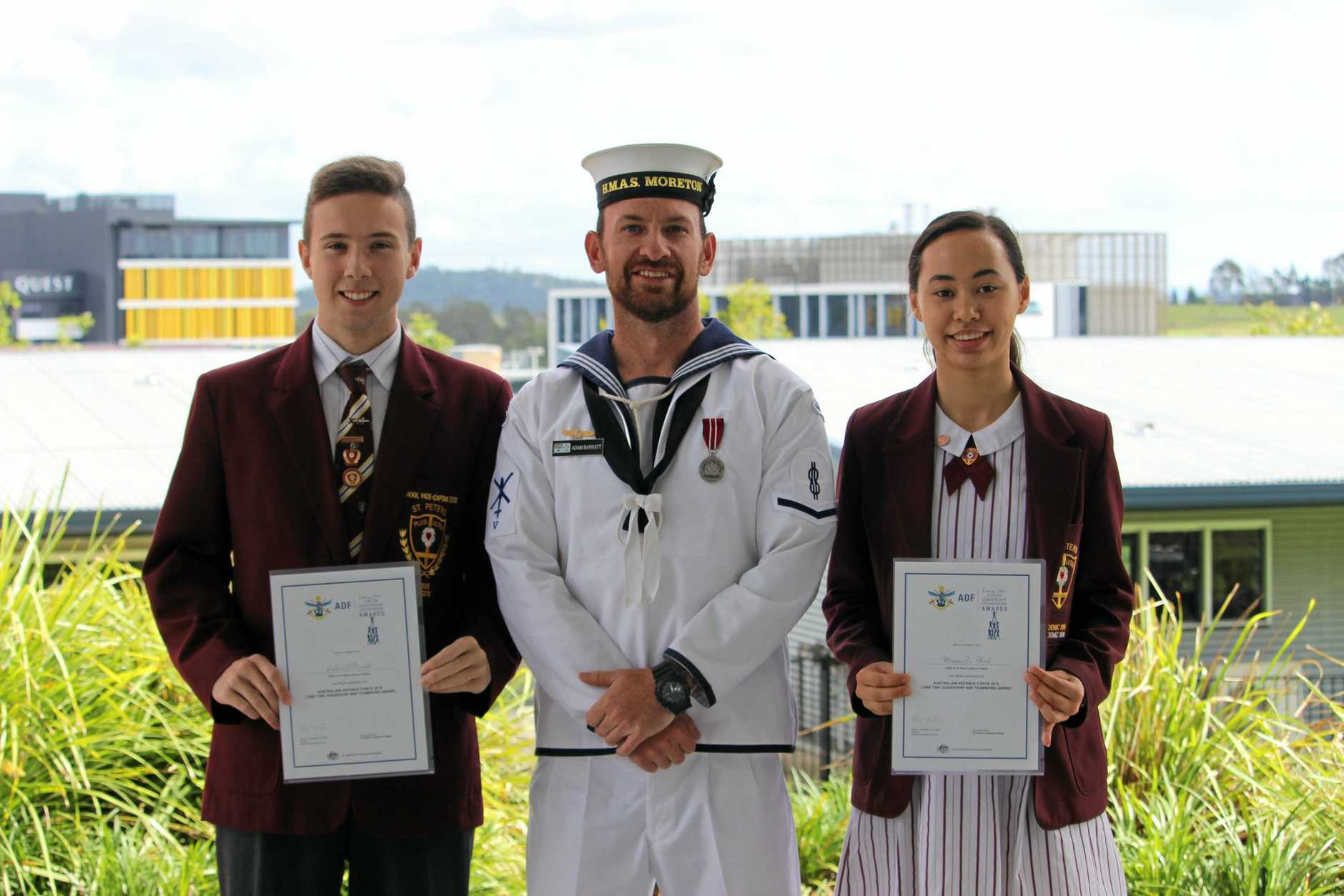 St Peters Lutheran College students Minami Hood and Lachlan Brindell were presented with Long Tan Youth Leadership and Teamwork Awards by Adam Barratt from the Defence Forces.