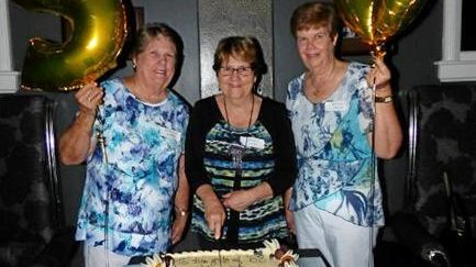 Cutting the reunion cake at the 50-year reunion for the Year 10 class of 1968 at OLMC (Mercy College) are, from left, Karen Stuart, Monica Slater and Ruth Borg.