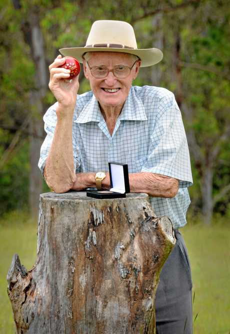 Gympie's Jim Geiger with his State Sport Volunteer Award medal on his Glastonbury property yesterday. Geiger has devoted six decades to volunteering and says wanted to give back more than he got from playing sport. Geiger thanks his wife Jessie for her support.
