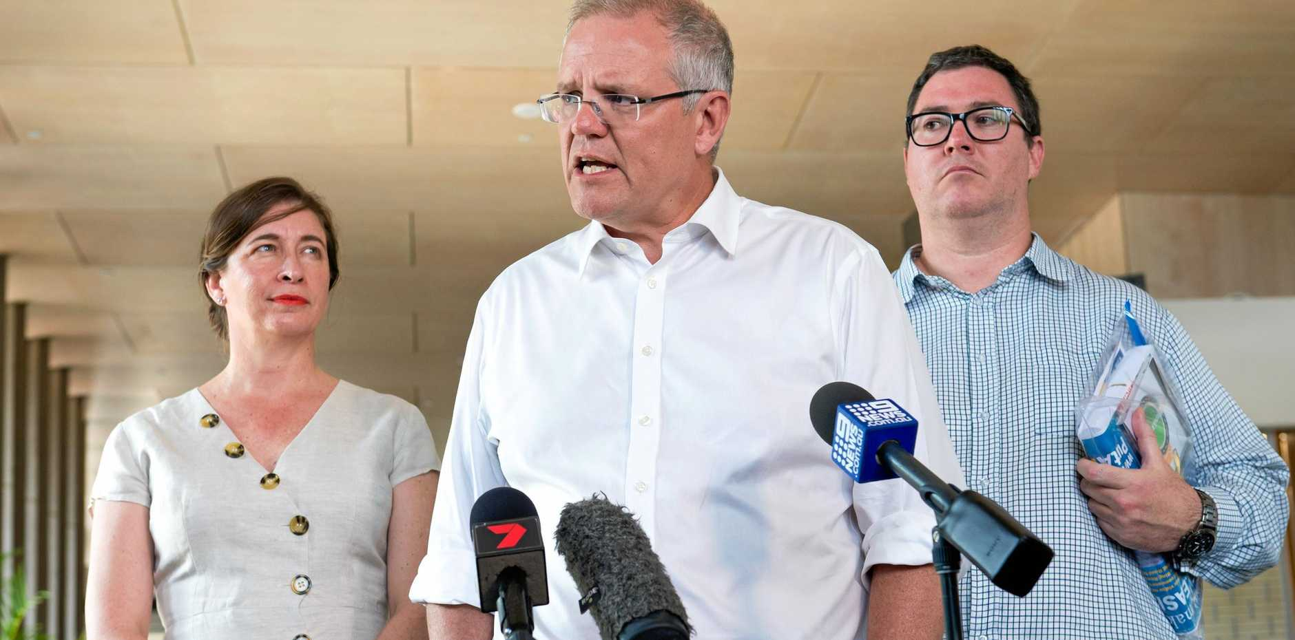 Prime Minister Scott Morrison talking at the Mackay Entertainment and Convention Centre on Thursday flagged by Liberals Senate candidate Susan McDonald and Federal Member for Dawson George Christensen.